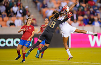 HOUSTON, TX - FEBRUARY 03: Priscilla Tapia #18 GK for Costa Rica attempts to make a save from advancing Jessica McDonald #14 of the United States during a game between Costa Rica and USWNT at BBVA Stadium on February 03, 2020 in Houston, Texas.