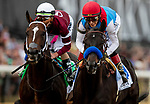 MAY 15, 2021: Medina Spirit with John Velazquez leads over Midnight Bourbon and Irad Ortiz in the Preakness Stakes at Pimlico Racecourse in Baltimore, Maryland on May 15, 2021. EversEclipse Sportswire/CSM