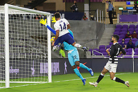 ORLANDO CITY, FL - JANUARY 31: Jonathan Lewis #14 of the United States battle for a ball during a game between Trinidad and Tobago and USMNT at Exploria stadium on January 31, 2021 in Orlando City, Florida.