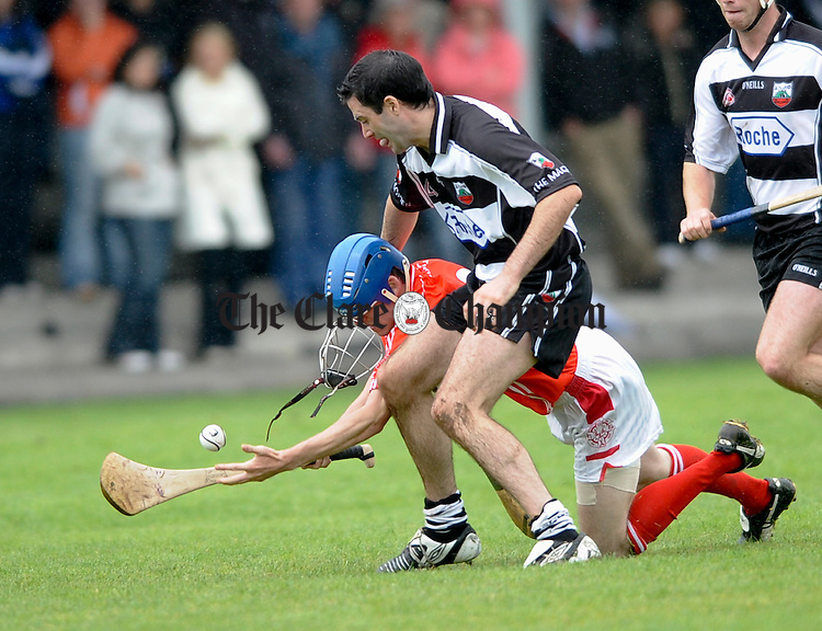 Eire Og's  Ronan Keane is tackled by Clarecastle's Mark Mc Namara during their championship game at Gurteen. Photograph by John Kelly.