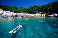 snorkeler swimming in a bay, Vela Luka, Korcula island, Croatia, Adriatic Sea, Mediterranean