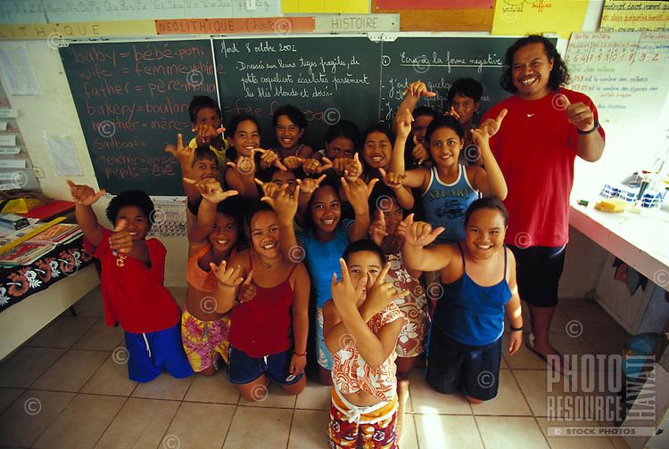 Group of Polynesian school kids with their teacher, in classroom in front of blackboard, Fatu Hiva, Marquesas, French Polynesia