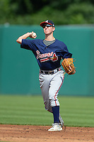 Shortstops Christian Hicks (10) of The Bolles High School in St. Augustine, Florida playing for the Atlanta Braves scout team during the East Coast Pro Showcase on July 31, 2013 at NBT Bank Stadium in Syracuse, New York.  (Mike Janes/Four Seam Images)