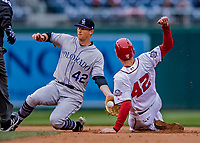 15 April 2018: Colorado Rockies infielder DJ LeMahieu gets Matt Wieters out at second on an attempted steal in the 8th inning against the Washington Nationals at Nationals Park in Washington, DC. All MLB players wore Number 42 to commemorate the life of Jackie Robinson and to celebrate Black Heritage Day in pro baseball. The Rockies edged out the Nationals 6-5 to take the final game of their 4-game series. Mandatory Credit: Ed Wolfstein Photo *** RAW (NEF) Image File Available ***