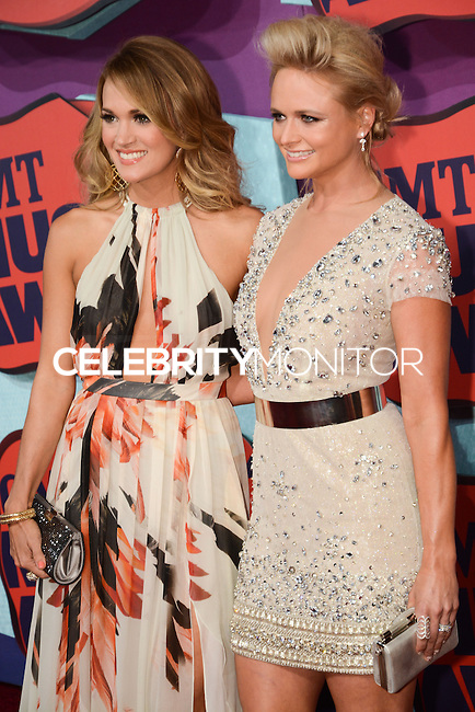 NASHVILLE, TN, USA - JUNE 04: Carrie Underwood, Miranda Lambert at the 2014 CMT Music Awards held at the Bridgestone Arena on June 4, 2014 in Nashville, Tennessee, United States. (Photo by Celebrity Monitor)