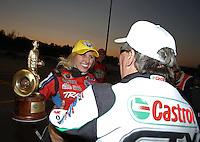 Feb. 17, 2013; Pomona, CA, USA; NHRA funny car driver Courtney Force celebrates with her father John Force after winning the Winternationals at Auto Club Raceway at Pomona. Mandatory Credit: Mark J. Rebilas-