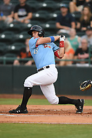Josh Jung (15) of the Hickory Crawdads follows through on his swing during game one of the Northern Division, South Atlantic League Playoffs against the Delmarva Shorebirds at L.P. Frans Stadium on September 4, 2019 in Hickory, North Carolina. The Crawdads defeated the Shorebirds 4-3 to take a 1-0 lead in the series. (Tracy Proffitt/Four Seam Images)