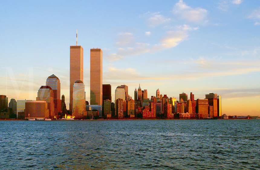Scenic cityscape of Lower Manhattan (World Trade Center Towers; center) at sunset. New York.