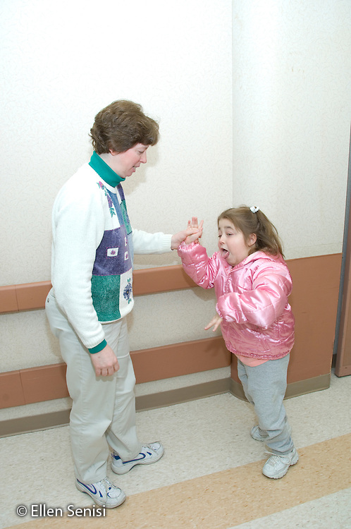 MR / Albany, NY.Langan School at Center for Disability Services .Ungraded private school which serves individuals with multiple disabilities.Physical therapist helps child walk. Girl: 11, cerebral palsy, non verbal with expressive and receptive language delays.MR: Pie3; Gor3.© Ellen B. Senisi