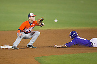 Auburn Tigers second baseman Jordan Ebert #23 waits for a throw as LSU Tigers outfielder Mark Laird #9 steals second base during the NCAA baseball game on March 23, 2013 at Alex Box Stadium in Baton Rouge, Louisiana. LSU defeated Auburn 5-1. (Andrew Woolley/Four Seam Images).