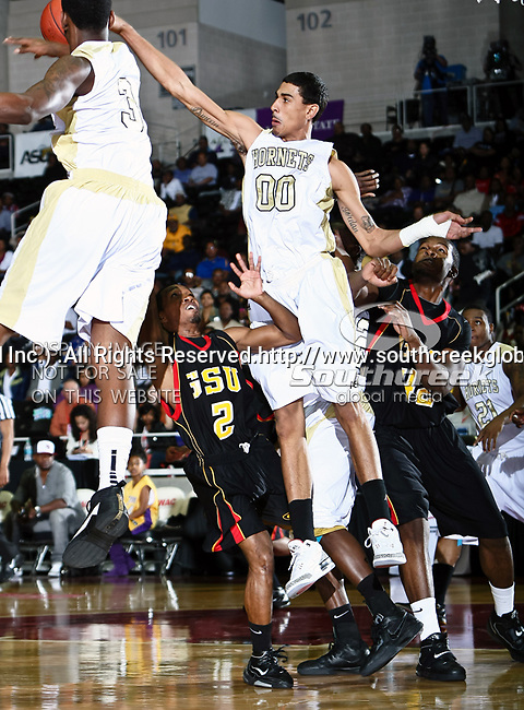 Alabama State Hornets forward Chris Duncan (0), Alabama State Hornets forward Shareif Adamu (3) and Grambling State Tigers guard Donald Qualls (2) in action during the SWAC Championship game between the Alabama State Hornets and the Grambling State Tigers at the Special Events Center in Garland, Texas. Alabama State defeats Grambling State 65 to 48.