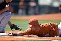 Texas Lonhorn  1B Tant Shepard dives back to first against Oklahoma State on Sunday April 25th, 2010 at UFCU Dish-Falk Field in Austin, Texas.  (Photo by Andrew Woolley / Four Seam Images)