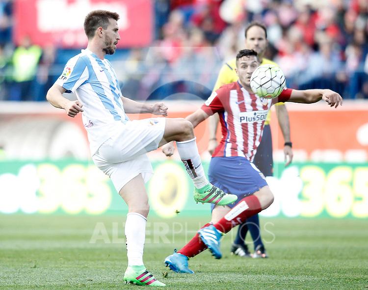Atletico de Madrid's Koke Resurrecccion (r) and Malaga CF's Ignacio Camacho during La Liga match. April 23,2016. (ALTERPHOTOS/Acero)