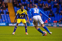 Saturday 25 January 2014<br /> Pictured: Paul Caddis tries to take the ball past Roland Lamah  <br /> Re: Birmingham City v Swansea City FA Cup fourth round match at St. Andrew's Birimingham