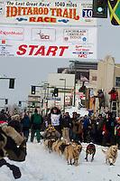 2010 Iditarod Ceremonial Start in Anchorage Alaska musher # 12 MATT HAYASHIDA with Iditarider BARRY WIEGLER