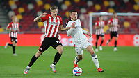 Marcus Forss of Brentford tries to take the ball past Rotherham's Ben Wiles during Brentford vs Rotherham United, Sky Bet EFL Championship Football at the Brentford Community Stadium on 27th April 2021