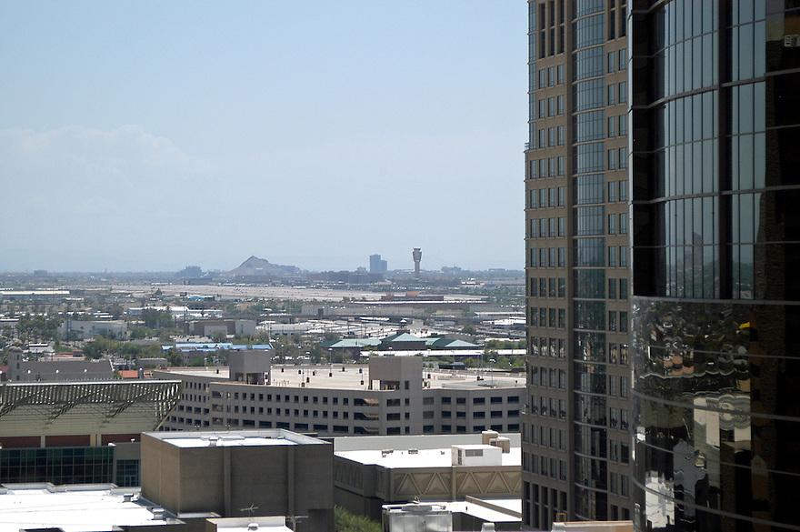 AJ Alexander/AJAimages - Downtown Phoenix, Arizona.Sky Harbor Tower in Smog.Photo by AJ Alexander