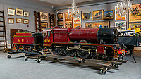BNPS.co.uk (01202 558833)<br /> Pic: MaxWillcock/BNPS<br /> <br /> Pictured: A 10 1/4 inch gauge model of the London Midland and Scottish tender locomotive No 6100 'Royal Scott, built from Bassett-Lowke castings and rebuilt by William Whiteley of Newark on Trent at D. Arundel & Co 1972, in the Dreweatts Donnington Priory saleroom.<br /> <br /> A remarkably detailed, functioning model steam engine is tipped to sell for £50,000 after attracting worldwide interest from train enthusiasts.<br /> <br /> The maroon 10.25ins gauge model of the London Midland and Scottish tender locomotive No 6100 'Royal Scott' was built in Bedfordshire in 1965.<br /> <br /> It underwent a significant restoration in 1972 and is still in a 'high quality' condition half a century later.<br /> <br /> The 8ft long locomotive weighs one tonne and has a steel boiler, a coal compartment, brakes, fitted steps, handrails and railway lamps.