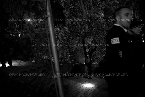 Chicago Illinois, USA<br /> October 2008<br /> <br /> Chicago police detective's look for evidence at the Jennifer Hudson home in Chicago. Hudson's mother, brother and nephew were murdered inside their home.