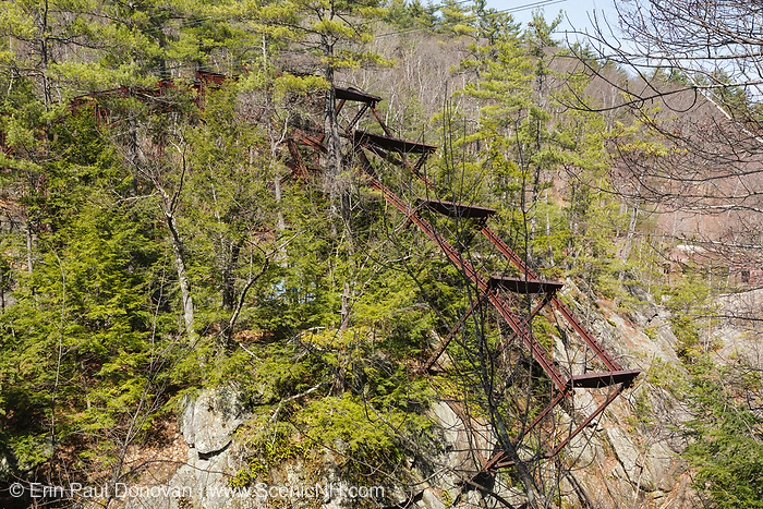 """Remnants of the """"Pumpkin Seed Bridge"""" at Livermore Falls in Campton, New Hampshire. This bridge was erected in 1886 by the Berlin Iron Bridge Company and crossed the Pemigewasset River. It is 263 feet long and closed in 1959."""