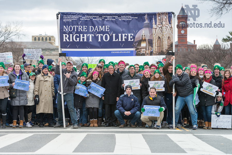 January 27, 2017; University of Notre Dame President Rev. John Jenkins, C.S.C., (center) stands with students, faculty, and staff from Notre Dame, Saint Mary's, and Holy Cross College for a group photo before marching at the National March for Life in Washington, D.C.  (Photo by Barbara Johnston/University of Notre Dame)
