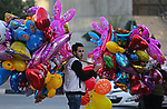 A Palestinian vendor sells ballons on the street in Gaza City on December 31, 2017 on the last day of the year. Photo by Ashraf Amra