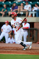 Greeneville Reds left fielder Reniel Ozuna (27) follows through on a swing during a game against the Pulaski Yankees on July 27, 2018 at Pioneer Park in Tusculum, Tennessee.  Greeneville defeated Pulaski 3-2.  (Mike Janes/Four Seam Images)