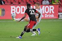 WASHINGTON, DC - AUGUST 25: Adam Buska #9 of New England Revolution battles for the ball with Donovan Pines #23 of D.C. United during a game between New England Revolution and D.C. United at Audi Field on August 25, 2020 in Washington, DC.