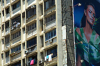 the contrast of Mumbai, Bollywood poster and appartment buildings, central Mumbai, india
