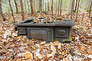 Artifact (cooking stove) at what is believed to be the abandoned Holland Camp in the Sabbaday Brook drainage of Waterville Valley, New Hampshire. The Holland Camp was a logging camp of the Swift River Railroad, which was in operation from 1906-1916. The Noyes & Goddard stove was produced from 1886-1902 +/-. The removal of historic artifacts from federal lands without a permit is a violation of federal law.
