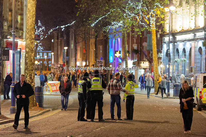 Pictured: Police patrol the area. Friday 14 December 2018<br /> Re: Revellers in Wind Street, Swansea, Wales, UK.