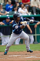 Corpus Christi Hooks outfielder Teoscar Hernandez (15) squares to bunt during the Texas League baseball game against the San Antonio Missions on May 10, 2015 at Nelson Wolff Stadium in San Antonio, Texas. The Missions defeated the Hooks 6-5. (Andrew Woolley/Four Seam Images)
