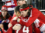 A FC Dallas fan hugs FC Dallas defender Matt Hedges (24) after the game between the FC Dallas and the Real Salt Lake at the FC Dallas Stadium in Frisco,Texas.