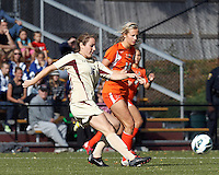 Boston College midfielder Patrice Vettori (18) passes the ball as University of Miami forward Ava Ambrose (16) closes..After two overtime periods, Boston College (gold) tied University of Miami (orange), 0-0, at Newton Campus Field, October 21, 2012.