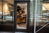 NEW YORK, NEW YORK - JUNE 2: A smashed door is seen after a night of looting due to protest on June 2, 2020 in New York City. Protests spread across the country in at least 30 cities across the United States, over the death of unarmed black man George Floyd at the hands of a police officer, this is the latest death in a series of police deaths of black Americans. New York face it's second night of a curfew (Photo by Joana Toro / VIEWpress via Getty Images)