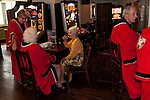 Damask Rose Ceremony Leicester 2016. Members of the Guild of Freemen enjoy a drink in the city centre O'Neill's pub after the ceremony.