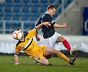Dumbarton's Garry Fleming goes in late on Falkirk's Will Vaulks.