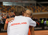 Februari 07, 2015, Apeldoorn, Omnisport, Fed Cup, Netherlands-Slovakia, Arantxa Rus (NED) defeates  Magdaléna Rybáriková (SLO) and falls into the arms of captain Paul Haarhuis<br /> Photo: Tennisimages/Henk Koster