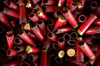 Photo story of Philmont Scout Ranch in Cimarron, New Mexico, taken during a Boy Scout Troop backpack trip in the summer of 2013. Photo is part of a comprehensive picture package which shows in-depth photography of a BSA Ventures crew on a trek.  In this photo used shotgun shells await reloading by the Boy Scouts. The reloaded shells are being used by the scout at the skeet shooting range in the backcountry at Philmont Scout Ranch.   <br /> <br /> The  Photo by travel photograph: PatrickschneiderPhoto.com