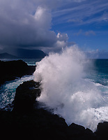 Waves Crashing against Rocky Coastline, Princeville, Kauai, Hawaii, USA.