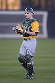 Siena Saints catcher Dave Hoffmann (25) during warmups before the season opening game against the Central Florida Knights at Jay Bergman Field on February 14, 2014 in Orlando, Florida.  UCF defeated Siena 8-1.  (Copyright Mike Janes Photography)