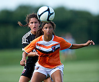 Molly Menchel (14) of the D.C. United Women stays close to Gloria Douglas (7) of the Charlotte Lady Eagles during the game at the Maryland SoccerPlex in Boyds, Maryland.  The D.C. United Women defeated the Charlotte Lady Eagles, 3-0, to win the W-League Eastern Conference Championship.
