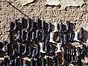 iraq 2006 .In the old market of Suleimania, boots on a wall.Irak 2006.Dans le marche de la vieille ville de Souleimania, presentation de bottes sur un mur
