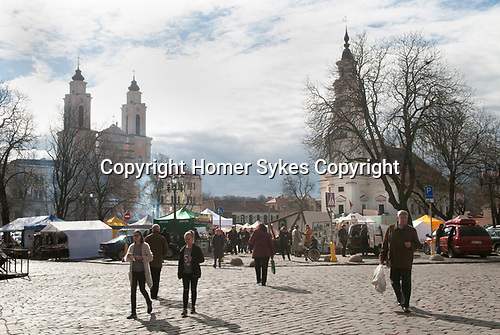 Kaunas Lithuania Church of St Francis Xavier  on left and the Old Town Hall on right, Town Hall Square people shopping the spring market. 2017 2010s,