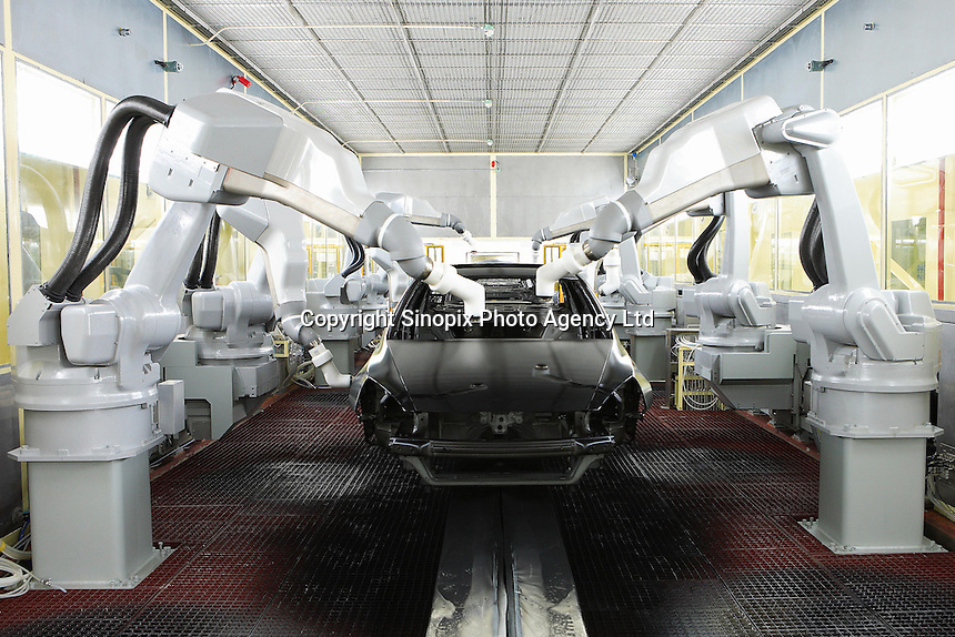 The production line of the Honda Accord at the new Guangzhou Honda Automobile Co. Ltd. factory. The plant built at a cost of 140 million US$ is one of the most advanced car plants in the world. It has a state of the art production line as well as the world's first total water re-cycling sytem.