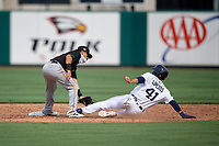 Pittsburgh Pirates shortstop Francisco Acuna (6) tags Andre Lipcius (41) out while sliding into second base during a Florida Instructional League game against the Detroit Tigers on October 16, 2020 at Joker Marchant Stadium in Lakeland, Florida.  (Mike Janes/Four Seam Images)