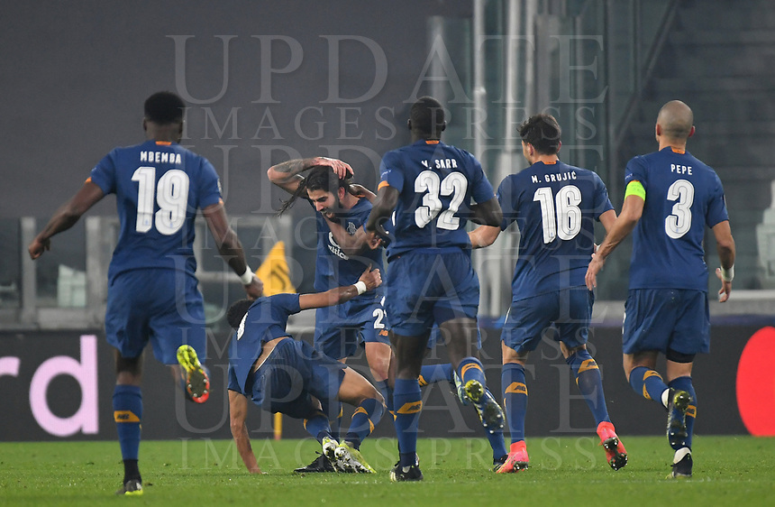 Football Soccer: UEFA Champions League -Round of 16 2nd leg Juventus vs FC Porto, Allianz Stadium. Turin, Italy, March 9, 2021.<br /> Porto's Sergio Oliveira (third L) celebrates  with his teammates  after scoring his second goal in the match during the Uefa Champions League football soccer match between Juventus and Porto at Allianz Stadium in Turin, on March 9, 2021.<br /> UPDATE IMAGES PRESS/Isabella Bonotto