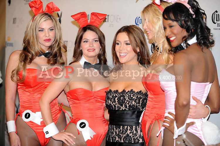 """Alyssa Milano poses with Playboy Playmates at Playboy's ninth annual """"Super Saturday Night""""  party in at Playboy's Desert Oasis and Resort in Chandler, Arizona Saturday February 2, 2008.   (Photo by Alan Greth)"""