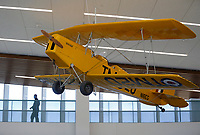 A De Havilland DH.82 Tiger Moth is visible Monday, February 22, 2021 suspended from the ceiling inside the preschool area of the Fayetteville Public Library's new expanded area in Fayetteville. The newly expanded library reopened last month with some sections unavailable to the public because of the covid-19 pandemic. Check out nwaonline.com/210223Daily/ and nwadg.com/photos for a photo gallery.<br /> (NWA Democrat-Gazette/David Gottschalk)