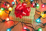 USA, Illinois, Metamora,  Close up of Christmas present and Christmas lights
